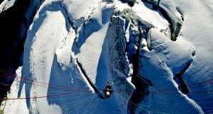 Birds eye view of paraglider flying over the Petit Combin glacier Switzerland